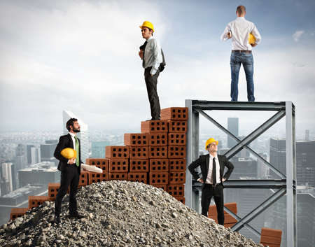Businessmen work together to build a building Stock Photo