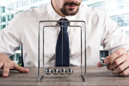 Business Newtons cradle Stock Photo - 76548358
