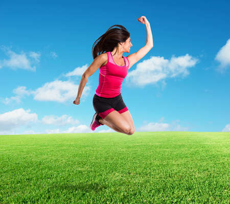 Vital and athletic girl jumps