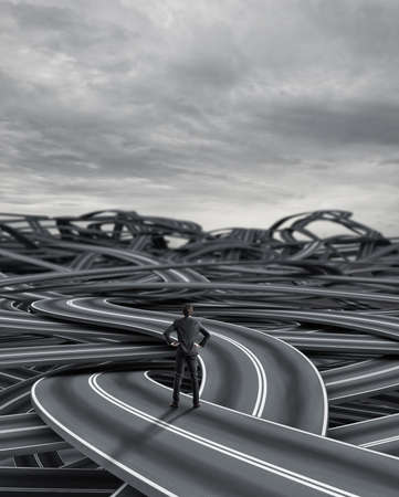 Confused businessman on a tangle of winding roads Stockfoto