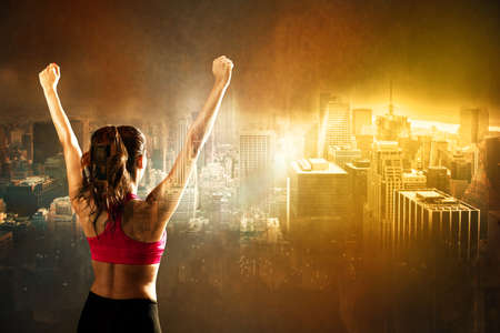 Athletic woman on city background Stock Photo