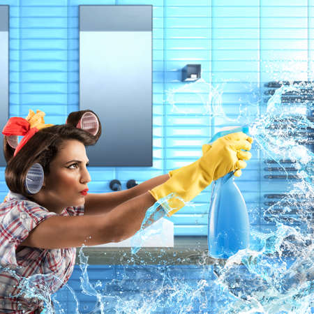 funny glasses: Housewife cleans with soap spray Stock Photo