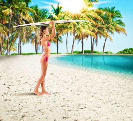 wave: Surfer girl in a tropical beach