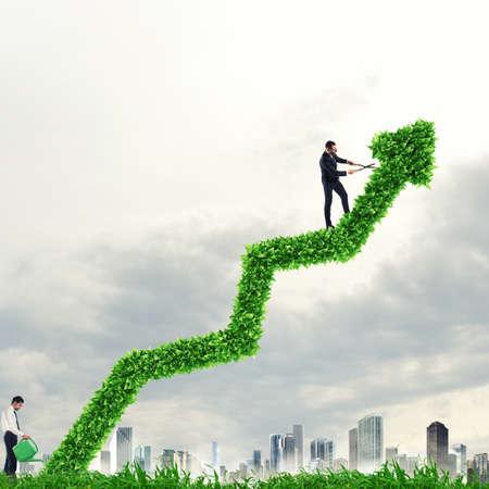 Big plant that grows like an arrow. Growing the economy company Stock Photo