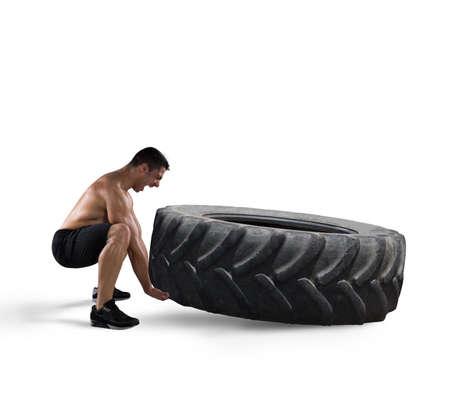 sportsman: Entrenamiento con un neumático grande Foto de archivo