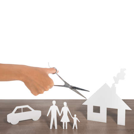 profession: Woman cut out silhouettes of family car and house Stock Photo