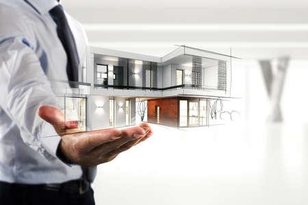 Zakenman die een modern kantoorproject toont