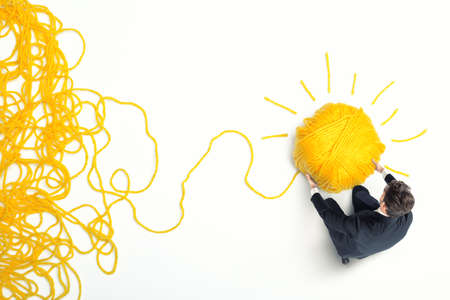 Concept of solution and innovation with tangle of wool yarn