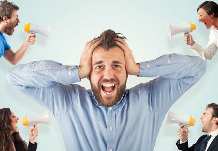 loud speaker: Stress concept with screaming colleagues Stock Photo