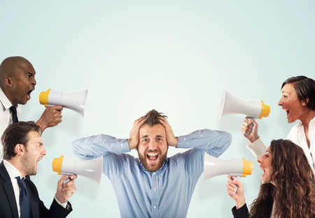 Stress concept with screaming colleagues photo