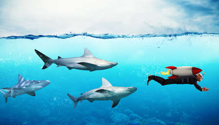 Concept of competition. Businessman escapes from sharks with a rocket