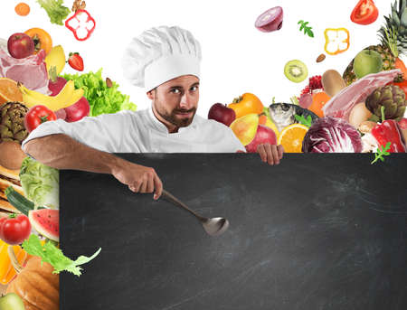 work: Chef with board and vegetables background