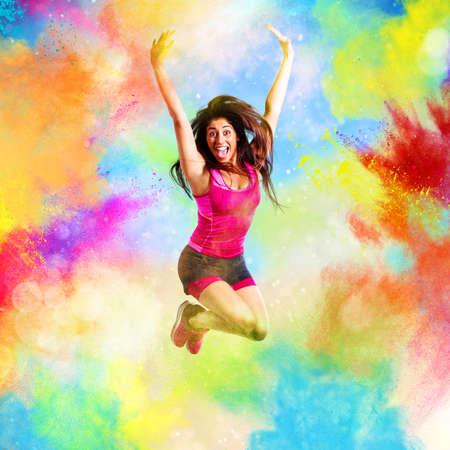 Fitness teacher jumps on summer colors photo