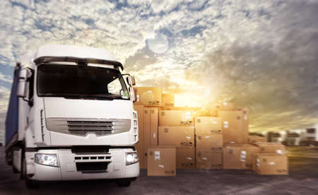 moving truck: Truck in a deposit with packages ready to start Stock Photo