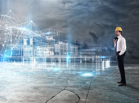 Businessman Architect analyzes a project of a building