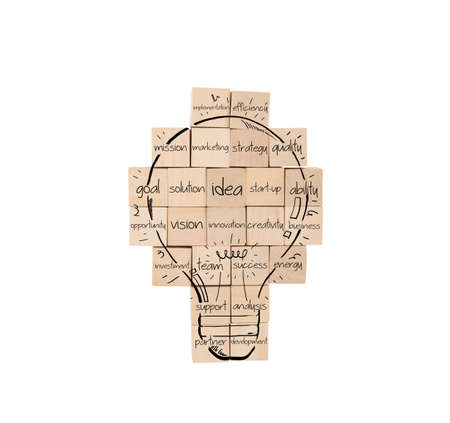 project: Building a new creative idea. brick wall with drawn lightbulb Stock Photo