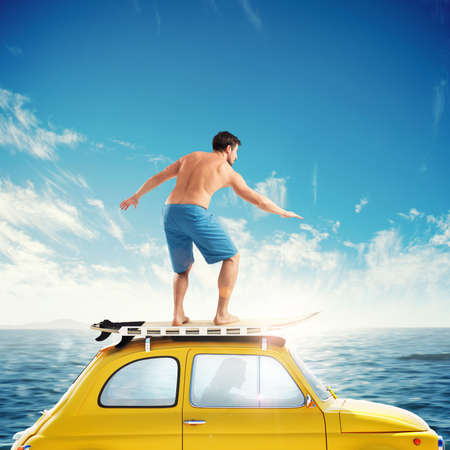 Old car with a surfing boy over the roof. 3D rendering Stock Photo
