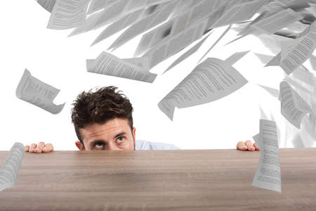 sheet of paper: Businessman afraid under the desk. concept of overwork Stock Photo