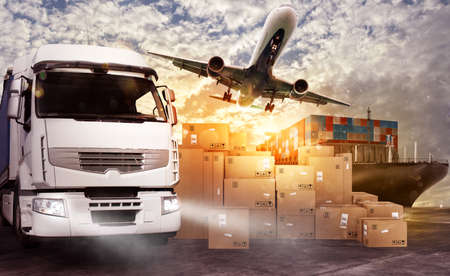 Truck, aircraft and cargo ship in a deposit with packages ready to start to deliver Stock Photo