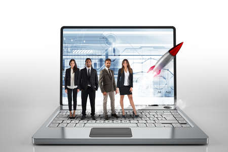 Team on a big laptop with a rocket ready to start. Concept of startup and innovation. 3D Rendering Stock Photo