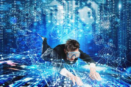 Businessman surfing the internet underwater with mask. Internet exploration concept Stok Fotoğraf
