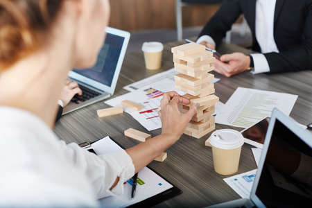 people: Team of business people build a wooden construction. concept of teamwork and partnership Stock Photo