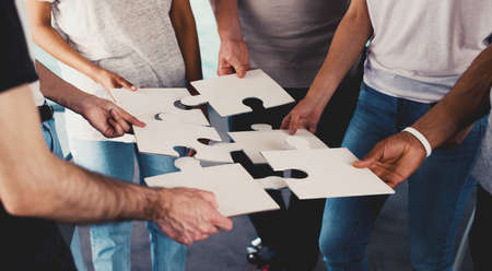 business: Team of businessmen work together for one goal. Concept of unity and partnership