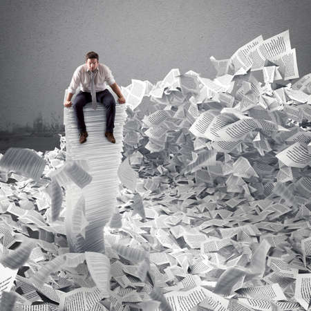 downfall: Businessman with paper sheet anywhere. Buried by bureaucracy concept.
