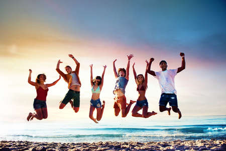 Happy smiling friends jumping at the beach Stock fotó - 82235742