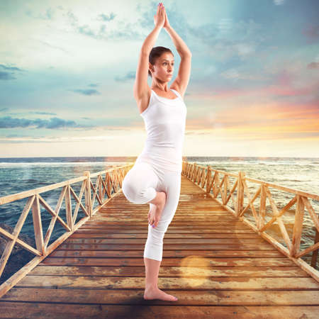 resting: Exercises of gymnastics on a pier