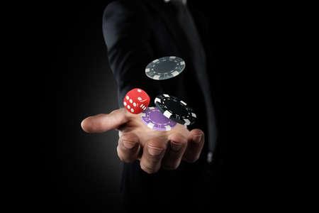 Rich Gambler makes his bet with chips Foto de archivo