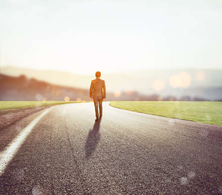 Man walks on an unknown road for a new adventure photo