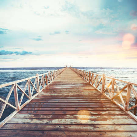 Pier on the sea at sunset Stock Photo