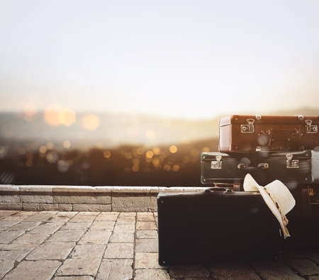 Luggage resting on a old stone pavement with background a panorama at sunset