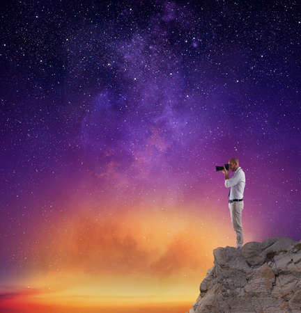 Photographer take a photo in a night sky full of stars photo