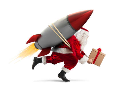 Fast delivery of Christmas gifts ready to fly with a rocket isolated on white background Foto de archivo