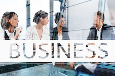 people: Team of businessmen work together in office. Concept of teamwork and partnership Stock Photo