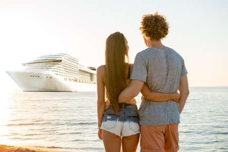 Happy smiling couple who travel by cruiseship. Concept of holiday and summertime Stock Photo