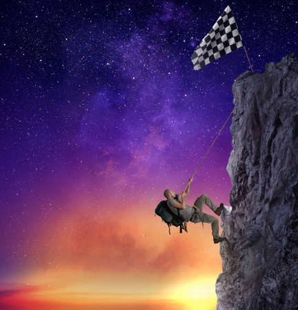 Businessman climb a mountain to get the flag. Achievement business goal and difficult career concept photo