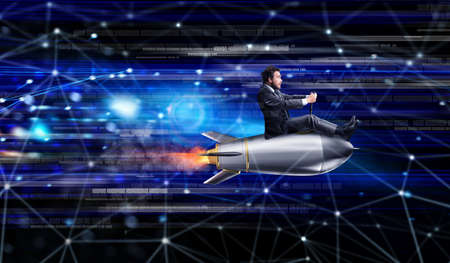 Fast internet concept with a businessman over a rocket