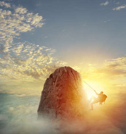 Businessman climb a mountain to get the flag. Achievement business goal and difficult career concept Imagens - 84939466