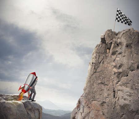 Entschlossenheit und Macht Geschäftsmann, der eine Rakete hält, um die Flagge zu erreichen Standard-Bild - 84939469