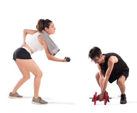 Muchacho y muchacha que tienen dificultad en el gym Foto de archivo