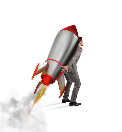 aspirational: Determination and power businessman that holds a rocket isolated on white background
