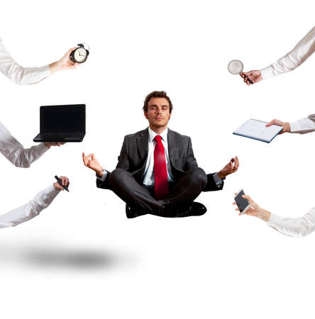 Relaxed businessman that does yoga during the work