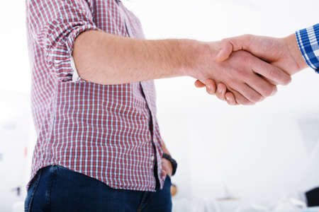 Handshaking business person in the office. concept of teamwork and business partnership