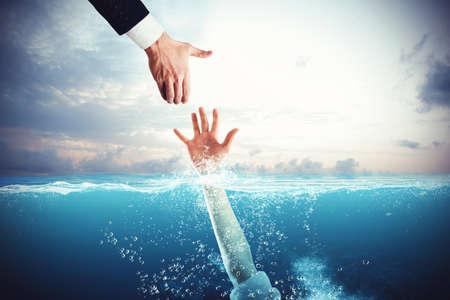 Zakenman neigt zijn hand om een persoon te redden die verdrinkt
