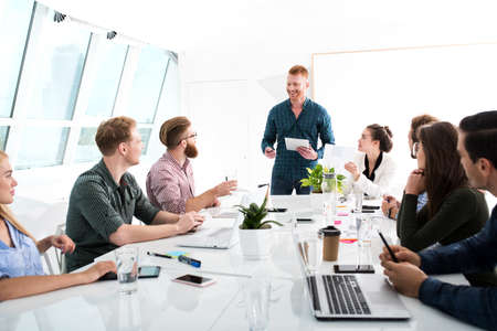 Team of businessmen work together in office. Concept of teamwork and partnership Stock Photo