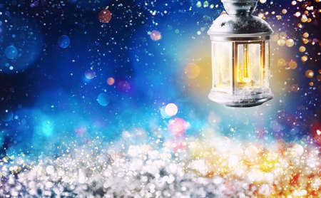 Shiny lantern on a Christmas background during the night Stock Photo