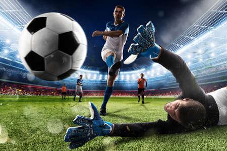 Bramkarz kopie piłkę na stadionie